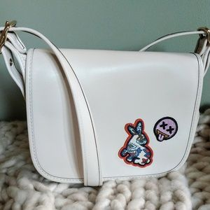 Coach Patricia Saddle 23 with Varsity Patches